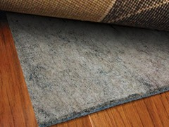 'Luxury Grip Indoor Rug Pad - 9 Sizes' from the web at 'https://d3gqasl9vmjfd8.cloudfront.net/3184f873-8d49-4fec-b375-72980249200d.jpg'